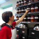 Donna pulling herb jar